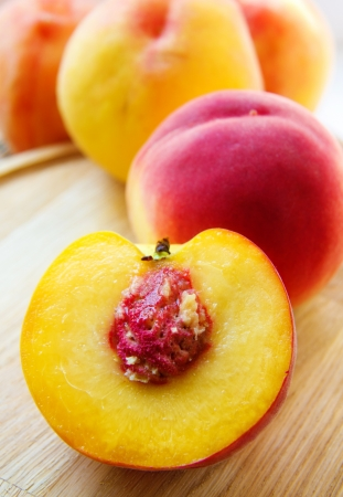 Half a peach close up on a colored background Stock Photo
