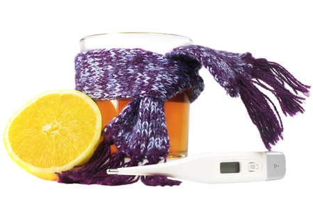 warming therapy: Thermometer, tea and lemon
