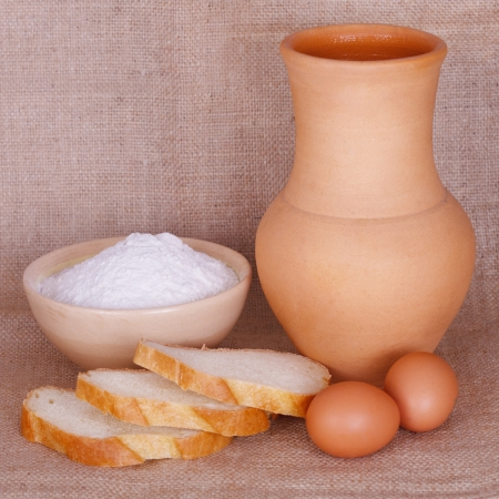 Flour, bread and a pitcher Stock Photo - 17329618