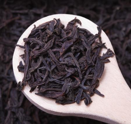 theine: Black tea loose dried leaves in spoon Stock Photo