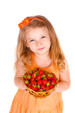 Happy little girl with strawberries Stock Photo