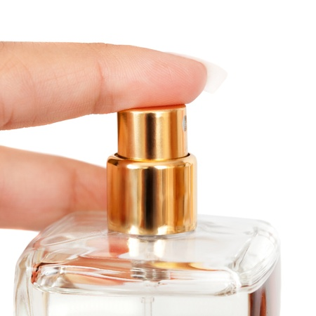 Hand with perfume bottle photo