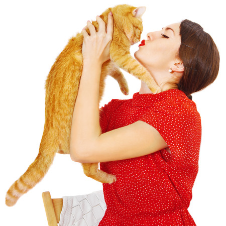 Beautiful smiling brunette girl and her ginger cat Stock Photo - 23948676