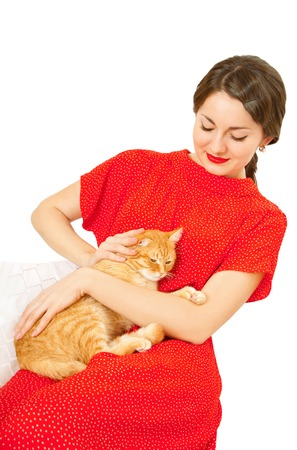 Beautiful woman in a red dress with a cat in arms Stock Photo - 23948678