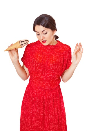 soiled: Lovely woman in a red dress soiled ice cream, isolated on white Stock Photo