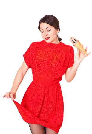 nuisance: Lovely woman in a red dress soiled ice cream, isolated on white Stock Photo