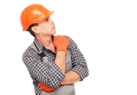 Construction worker thinking and looking away, isolated on white