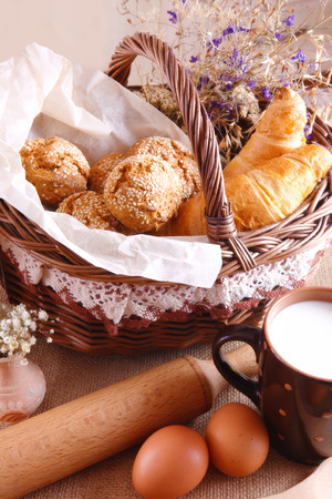 fresh pastries and a cup of milk