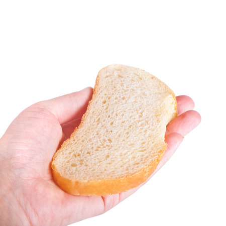 A slice of bread on the palm photo