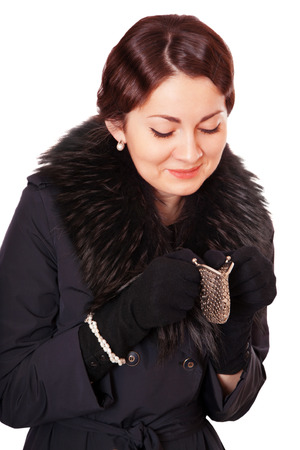 stingy: Luxury woman in a black coat looks into an empty wallet