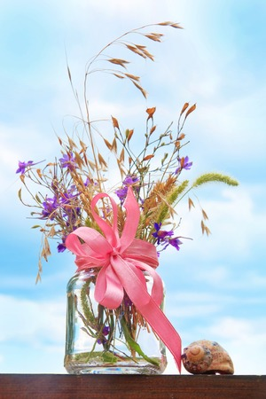 Still life with flowers in a transparent bank photo