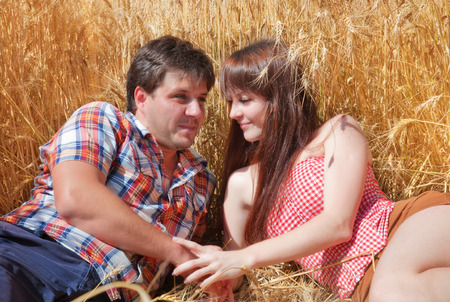 Man and woman embracing in a field photo