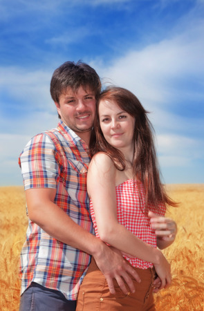 Man and woman embracing on nature Stock Photo