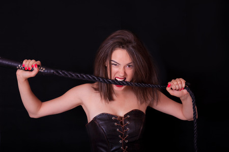 Woman with a whip in her hand