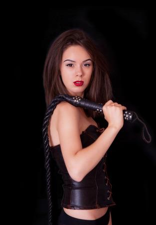 dominacion: Mujer con un l�tigo en la mano Foto de archivo