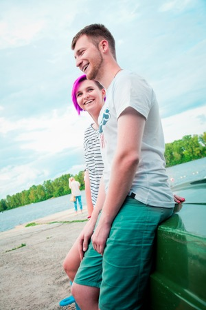 upturned: Man and woman sitting on an upturned boat