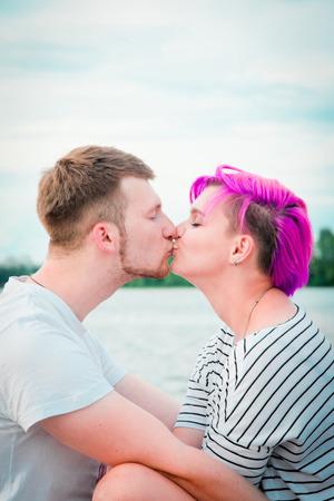 Close up of a young couple visiting at river bank photo