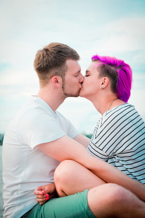 Young couple hugging and kissing on the nature photo