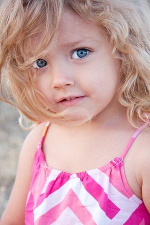 dreamy eyed: Summer portrait of a little girl outdoor
