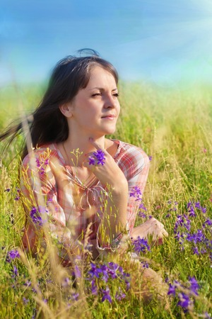 Portrait of girl on nature in flowers