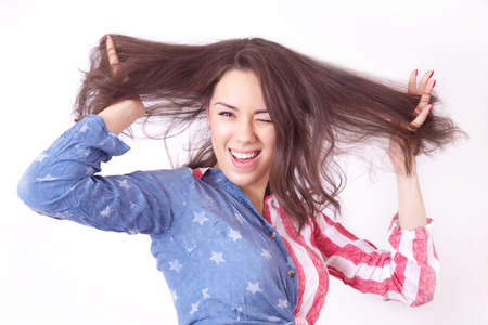 unruly: Cheerful smiling girl with unruly brown hair