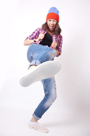 Teenage girl in torn jeans Stock Photo - 34176998