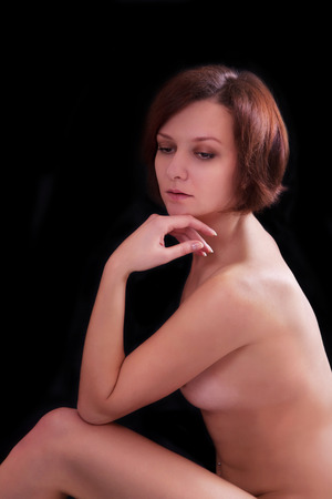 nude young woman: Nude young woman on a black background