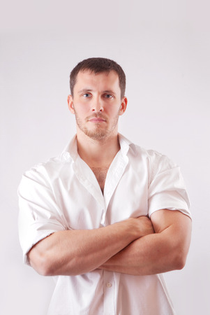 Man with white shirt over white background