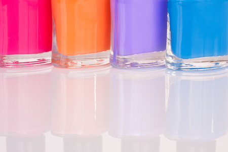 smartness: Four multi-colored bright nail polish with reflection