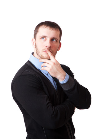 Attractive man thoughtfully rubbing his chin, isolated on white background