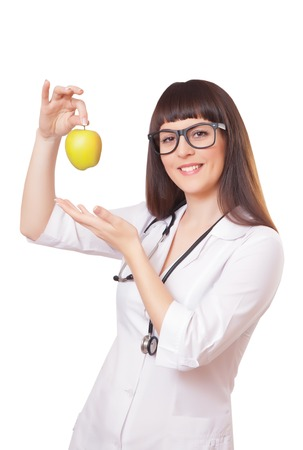family physician: Woman in a white lab coat with apple, isolated on white background Stock Photo