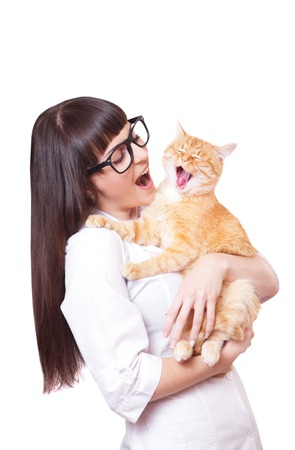 cat isolated: Portrait of a beautiful woman holding red cat, isolated on a white background
