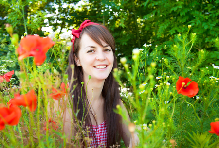 young  brunette: Portrait of a young beautiful woman in nature on a sunny summer day