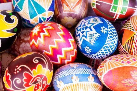 basket: Mix of colored eggs with the traditional designs