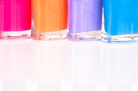 smartness: Four brightly colored nail polish on the table close-up Stock Photo