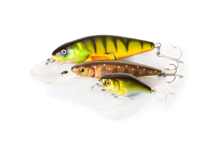 Three wobbler for fishing on white background