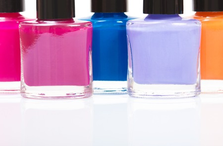smartness: Several colored nail polish on a table Stock Photo