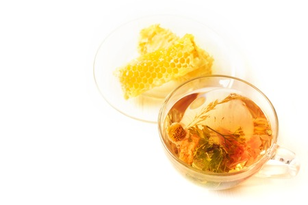 Herbal tea and honeycomb on a white table