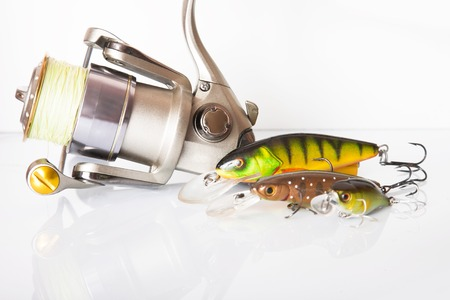 wobbler: Spinning rod and reel with wobbler lure on white background