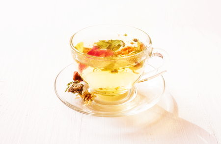 herbal tea: Herbal tea in a transparent cup on the white table closeup Stock Photo