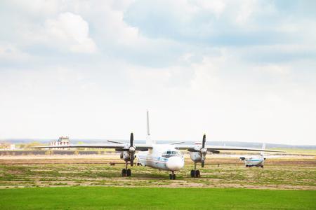 aerodrome: Old aircraft on the alternate aerodrome on a cloudy day Stock Photo