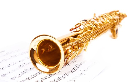 Musical notes and saxophone, isolated on white
