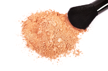 blush: Powder blush and black makeup brush on white background