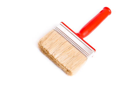 redecorate: Red brush for painting and decoration on white background Stock Photo
