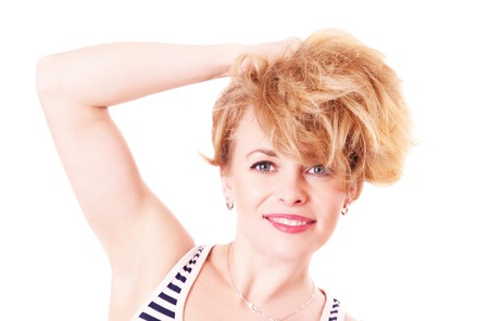 unruly: Cheerful funny woman with shaggy hair, isolated on white background