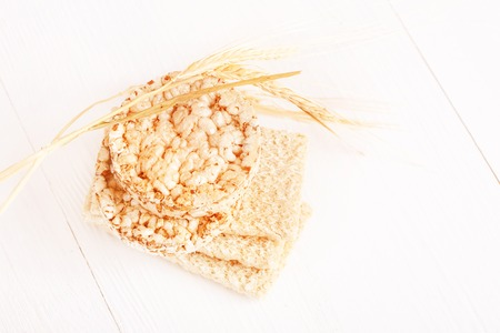 caloric: Dietary a low caloric grain crackers on a white background Stock Photo