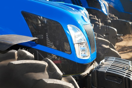 traction engine: Close up of blue modern tractors on a row Stock Photo