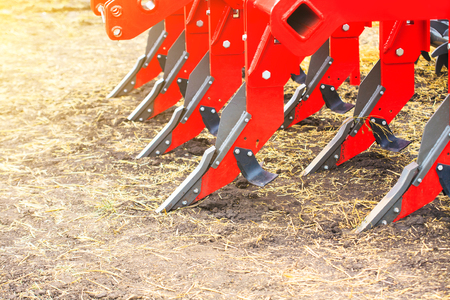Plough close-up on the ground, farm equipment Stock Photo