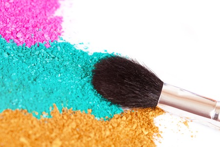 Powdery eyeshadow makeup and brush on a white background Stock Photo