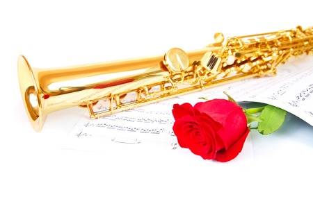 Musical notes and saxophone with red rose Stock Photo